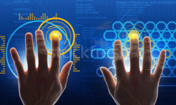 Hands touching blue holographic screen Stock photo © cherezoff