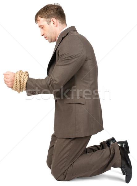 Young man kneeling Stock photo © cherezoff