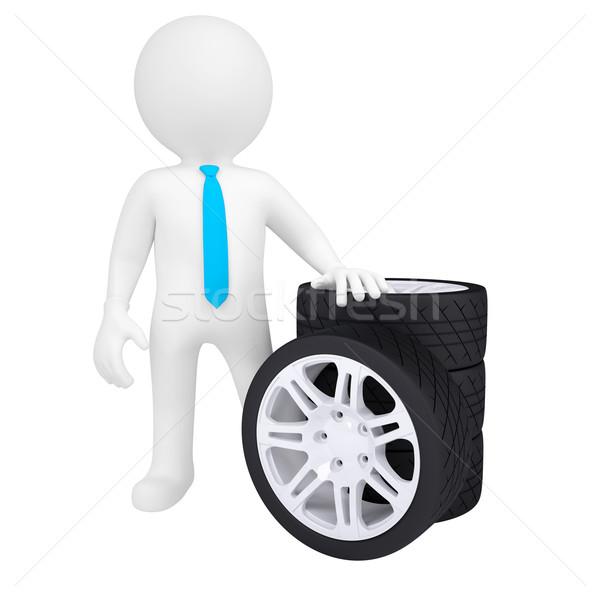 3D man holding a car wheel Stock photo © cherezoff