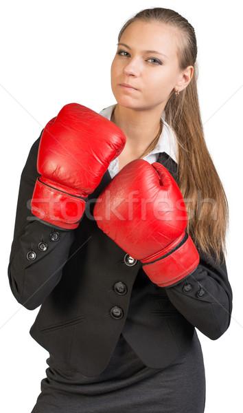 Kobieta interesu rękawice bokserskie twardy wygląd kamery Zdjęcia stock © cherezoff