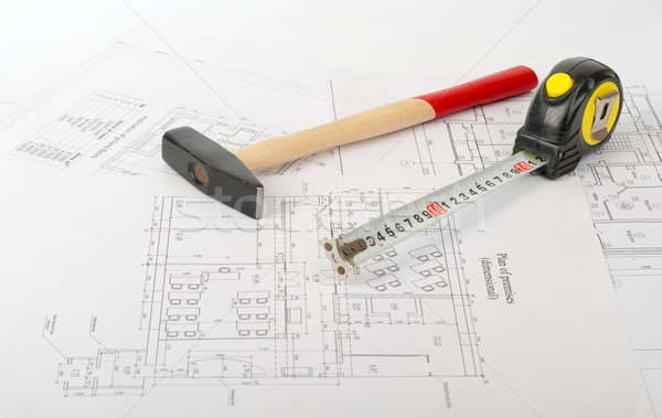 Hammer with tape measure on draft Stock photo © cherezoff
