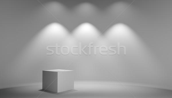 Stock photo: White cube in gray studio