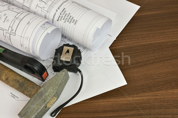 Construction drawings, tape, hammer and level Stock photo © cherezoff