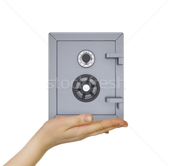 Hand holding safe Stock photo © cherezoff