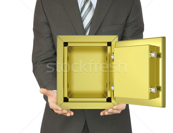 Man in a suit holding open gold safe Stock photo © cherezoff