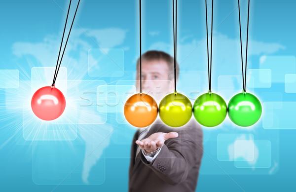 Geschäftsmann Anzug halten Wiege Weltkarte Mann Stock foto © cherezoff