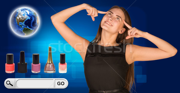Beautiful woman facing choice. bottles of nail polish, Globe and search bar with Go button beside Stock photo © cherezoff