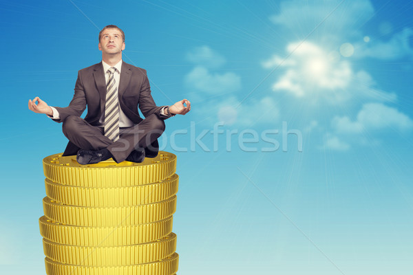 Businessmanin in lotus posture on coins stack Stock photo © cherezoff