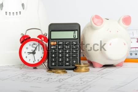 ébresztőóra számlák érmék izolált fehér számológép Stock fotó © cherezoff