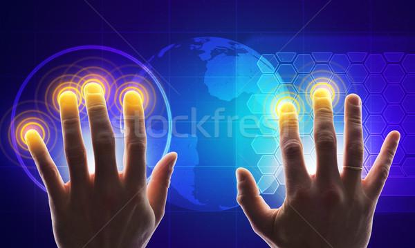 Kezek holografikus képernyő megérint világtérkép Stock fotó © cherezoff