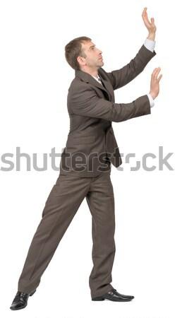 Businessman pushing empty space, side view Stock photo © cherezoff
