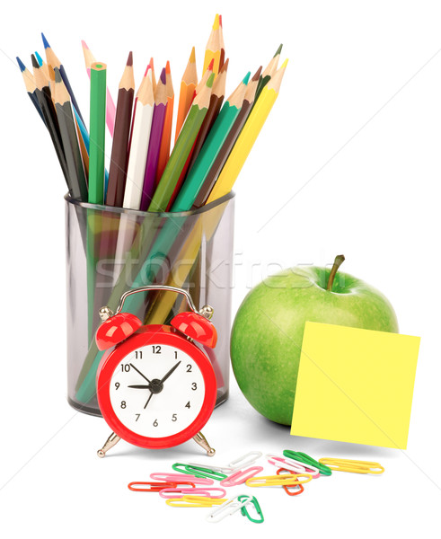 Alarm clock with apple and crayons Stock photo © cherezoff