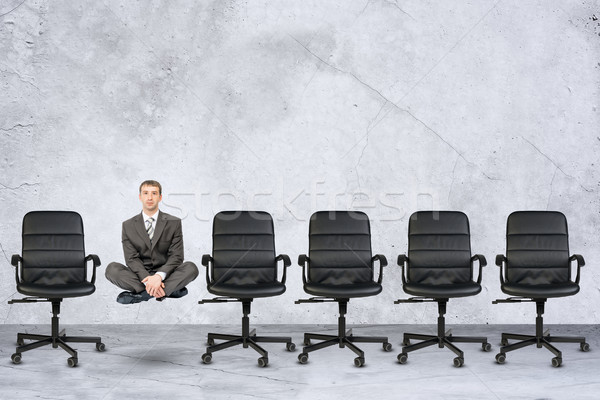 Businessman in lotus posture Stock photo © cherezoff