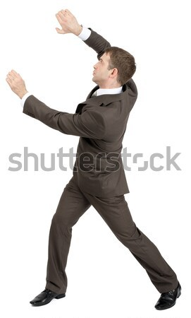 Businessman holding invisible thing Stock photo © cherezoff