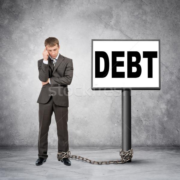 Businessman word debt on post sign Stock photo © cherezoff