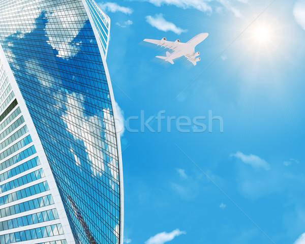 Skyscraper with jet Stock photo © cherezoff