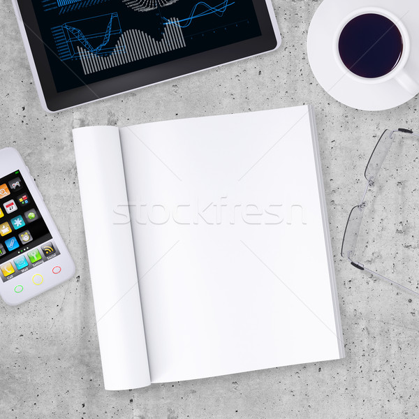 Blank note pad with tablet PC, smartphone, cup of coffe and glasses placed around it Stock photo © cherezoff