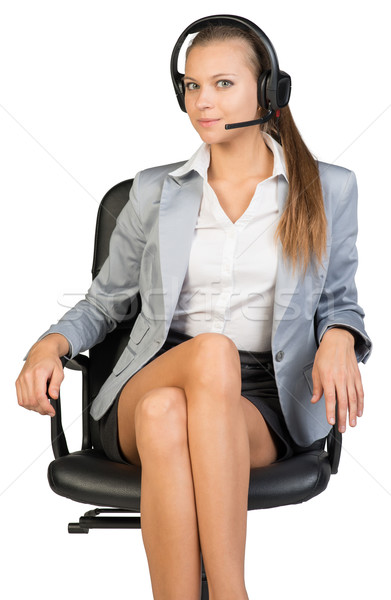 Businesswoman in headset sitting on office chair Stock photo © cherezoff