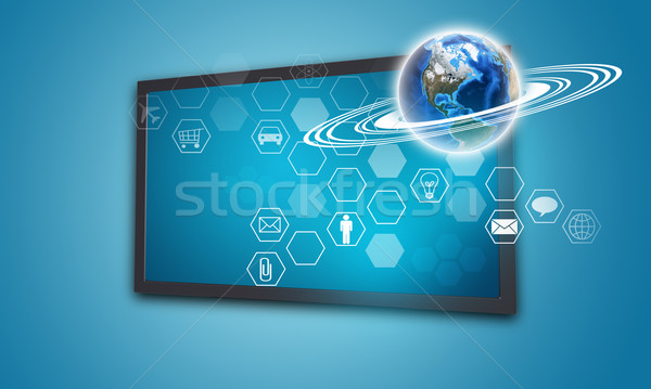 Touchscreen display with Globe and hexagons, on blue background Stock photo © cherezoff