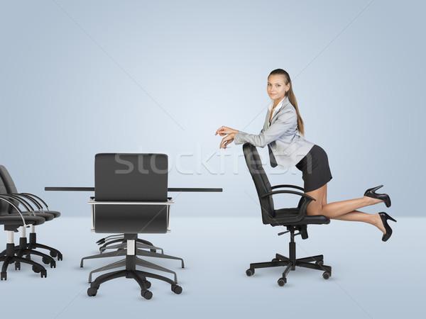 Térdel szék néz kamera üzlet centrum Stock fotó © cherezoff