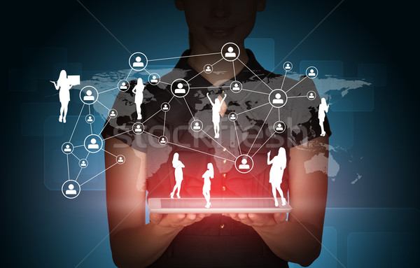 Businesslady with tablet and peoples silhouette Stock photo © cherezoff