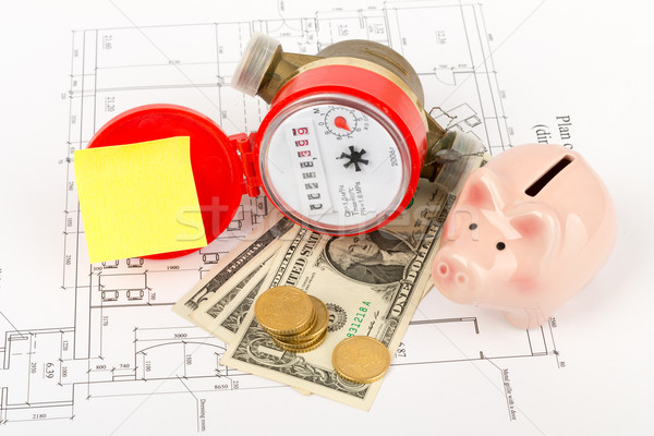 Water meter with piggy bank and sticker on draft Stock photo © cherezoff
