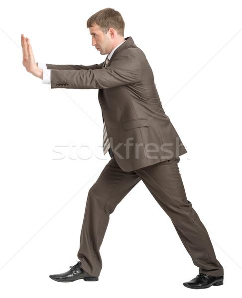 Empresário empurrando para a frente branco isolado Foto stock © cherezoff