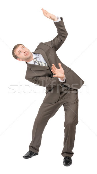 Businessman bending and looking up Stock photo © cherezoff