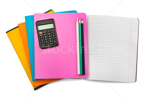 Nyitva notebook szett zsírkréták számológép izolált Stock fotó © cherezoff