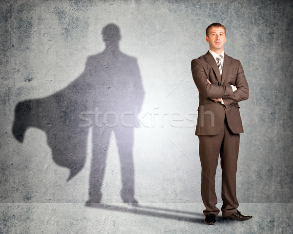 Businessman with superman shadow Stock photo © cherezoff