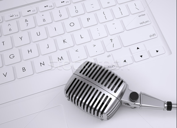 Old microphone on the keyboard Stock photo © cherezoff