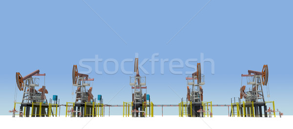 Oil pump-jacks on white plane. Front view Stock photo © cherezoff