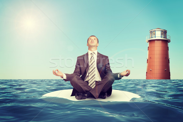 üzletember ül lótusz pozició sziget kicsi Stock fotó © cherezoff