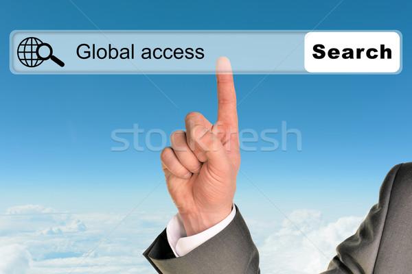 Businessmans hand on blue sky background Stock photo © cherezoff