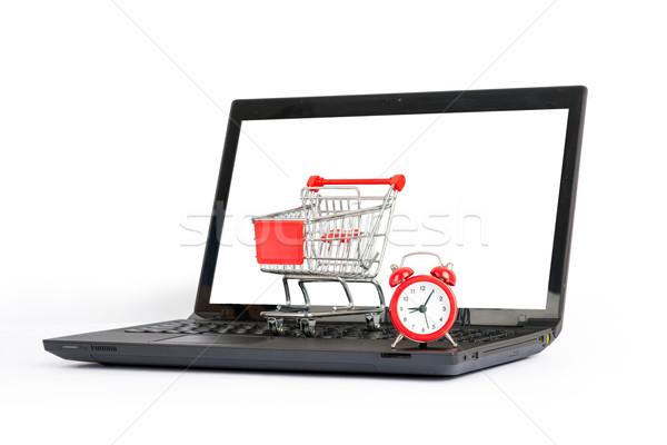 Bevásárlókocsi ébresztőóra laptop zárt kilátás izolált Stock fotó © cherezoff
