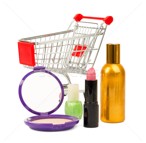 Shopping cart with nail polish and powder Stock photo © cherezoff