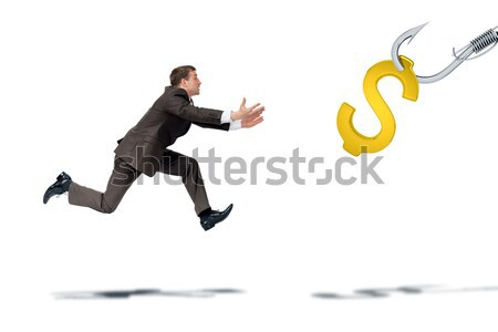 Businessman trying to catch dollar sign Stock photo © cherezoff