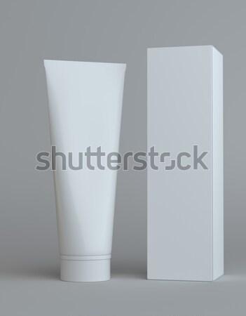 White cream bottle and tall paper box Stock photo © cherezoff