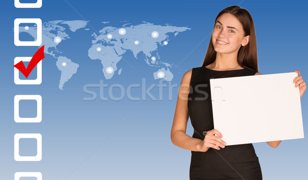 Businesswoman with checkboxes and world map Stock photo © cherezoff
