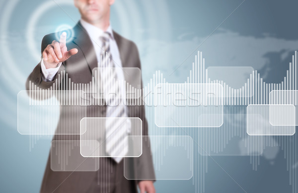 Businessman presses virtual button. Graphs, rectangles and world map Stock photo © cherezoff