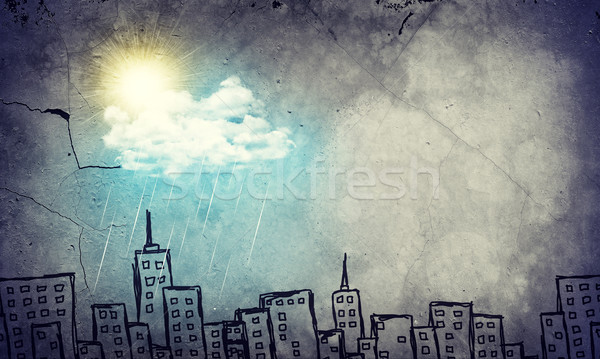 Concrete wall with sketches of buildings. Sun was shining and pouring rain Stock photo © cherezoff