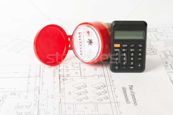 Water meter with calculator on draft Stock photo © cherezoff