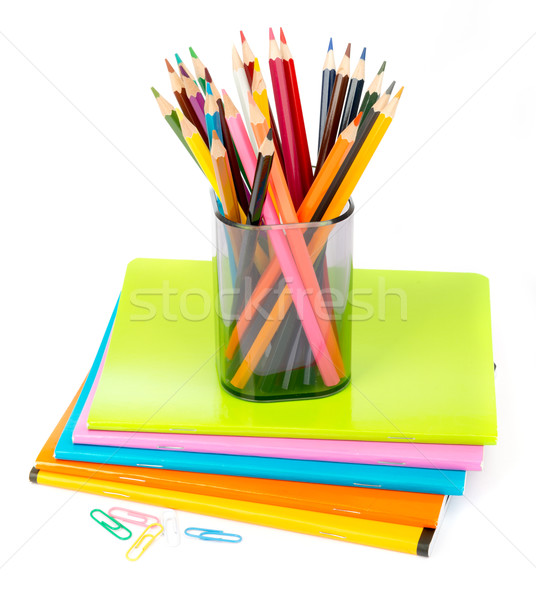 Pencil cup with crayons and clips on copybooks Stock photo © cherezoff