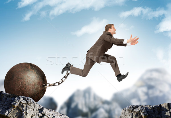 Businessman jumping over gap Stock photo © cherezoff