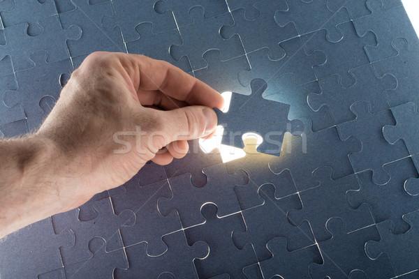 Missing jigsaw puzzle piece with light glow Stock photo © cherezoff