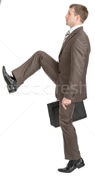 Businessman making big step with suitcase Stock photo © cherezoff