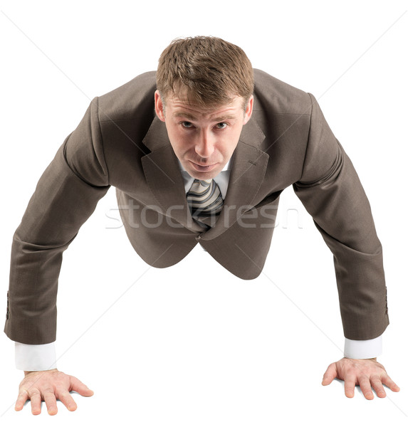 Stock photo: Businessman doing push-ups