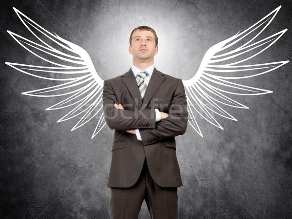 üzletember angyalszárnyak rajzolt néz kamera angyal Stock fotó © cherezoff