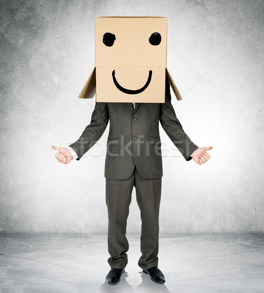 Businessman with box on head and smiley face Stock photo © cherezoff