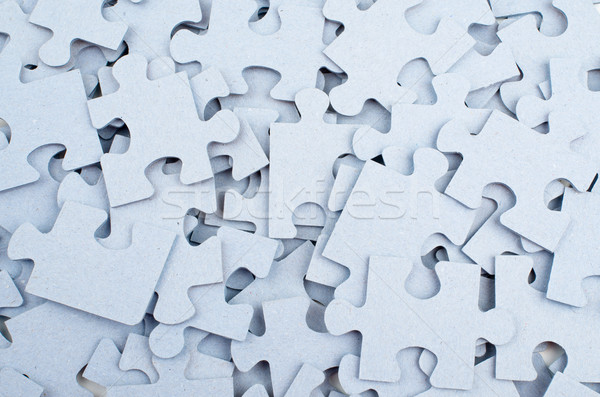 Pile of grey blank puzzle pieces background. Stock photo © cherezoff